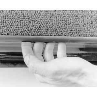 III - Place your hands under the edge of the door panel to separate the securing clips from the door . . ..jpg